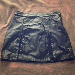 Dresses & Skirts - Faux Leather mini skirt with front tie detailing